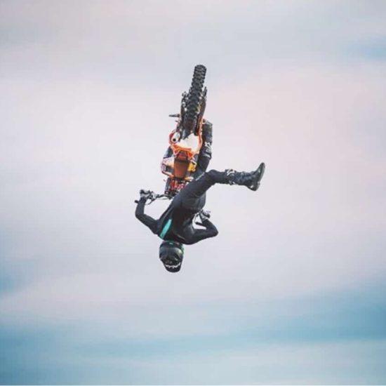 Tyler Wakeford doing a flip Mac nac in intent motocross gear
