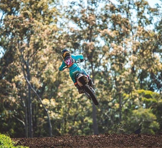 Tyler Collins in the quake teal Dirt bike gear