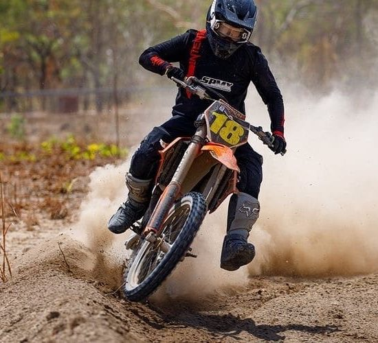 Corey Rice in the blackout pinned red/black. Moto gear