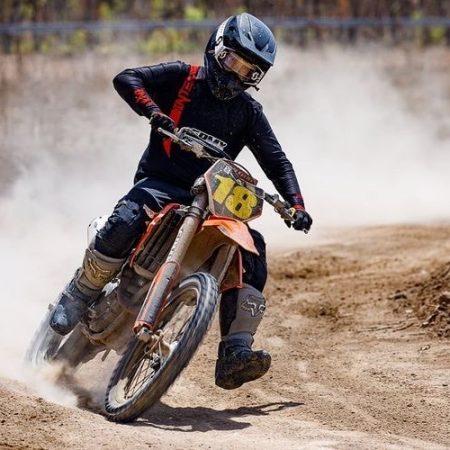 Corey rice cornering in intent Mx Black motocross gear