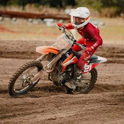 red motocross gear worn by deacon page with a red helmet on a Kym dirt bike racing in Western Australia