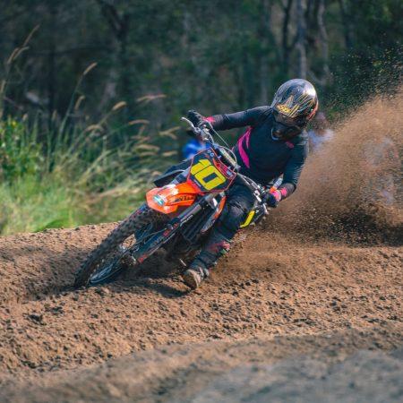 Jayden Binger aboard his ktm 250cc dirt bike kitted in black and pink motocross gear