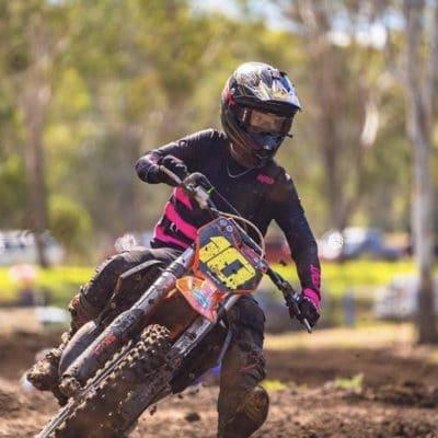 Jayden Binger in the blackout Drapht white and black dirt bike gear