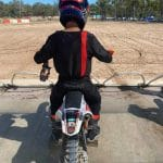 Jacob Salih on the start gate wearing our blackout red and black dirt bike gear