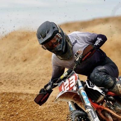 Charlie Bartlett running white and black dirt bike gear aboard a ktm 85cc motorbike