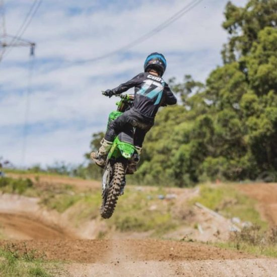 Intent Mx Athlete Cody Kilpatrick aboard his kx250f shredding in the infinite dirt bike jersey, pant and glove combo.