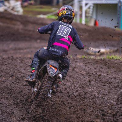 Black and fluoro pink motocross gear made by Australian brand intent Mx. The blackout gear line worn by Jayden Binger aboard his ktm 125 dirt bike