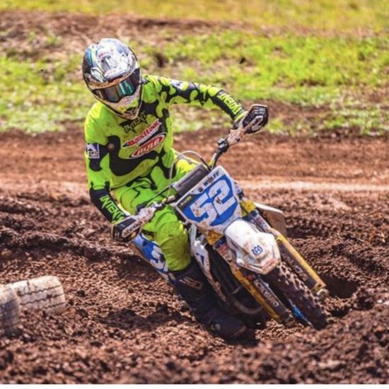 Kobi Wolff aboard his huscvarna fc 250 tipping it in a left hand corner and looking fabulous in the jigsaw Fluoro yellow motocross gear set