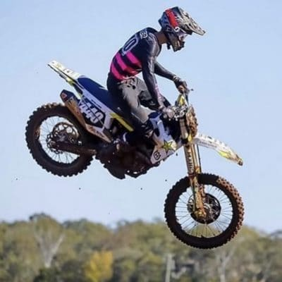 Jai walker aboard his husqvarna fc450 kitted with the intent Mx dirt bike jersey and pants. FluoroPink and black moto gear