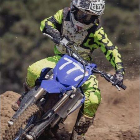 Dj sankovic aboard a Yamaha yz65 running bright yellow motocross gear