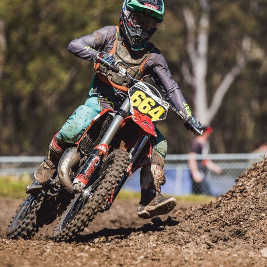 Teal and grey dirt bike gear