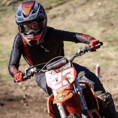 Black and red motocross gear worn by Lachlan Morris aboard his ktm 85 dirt bike.
